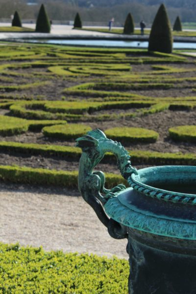 IMAGE: A small dragon sculpture in the foreground of the magnificent gardens