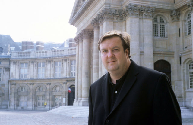 IMAGE: Picture showing Andrew Hussey OBE outside historic building