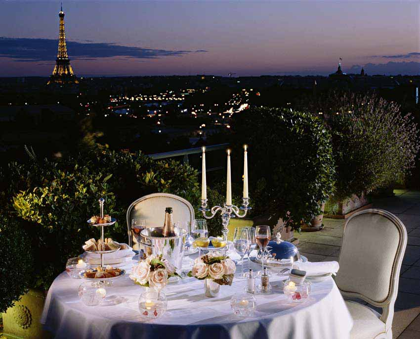 IMAGE: Table set for two with a view over the Eiffel Tower