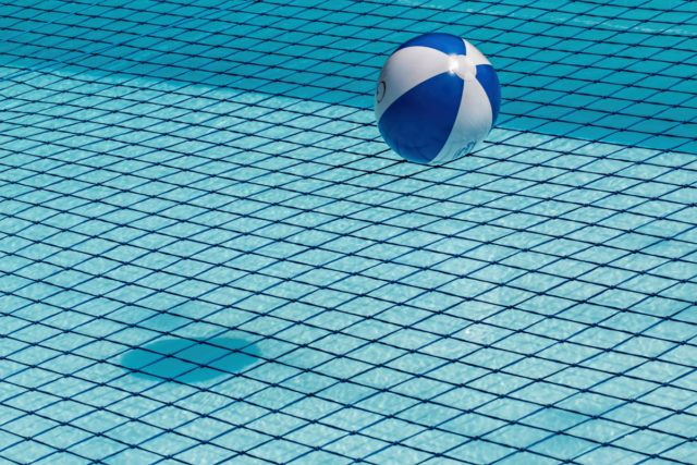 IMAGE: Photo of beach ball in swimming pool