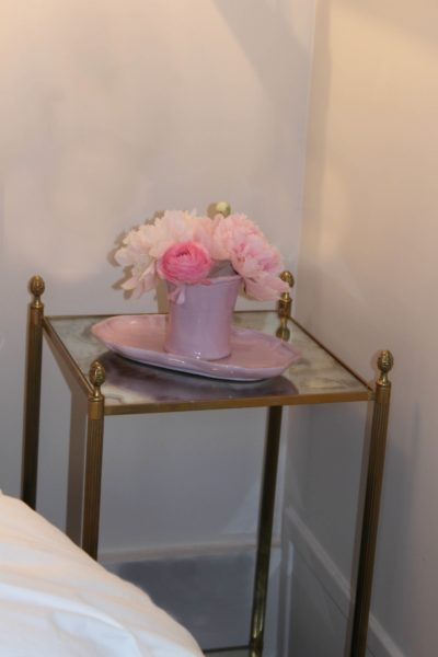 IMAGE: Antique table with vase of flowers