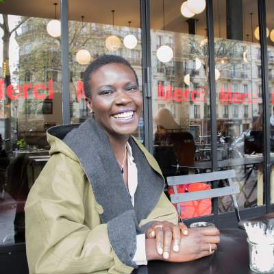 IMAGE: Parisian blogger Yanique Francis sitting outside one of her favourite cafes