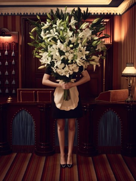 IMAGE: Abstract photo of maid with bouquet of white flowers at Hôtel Bourg Tibourg for hip hotels feature
