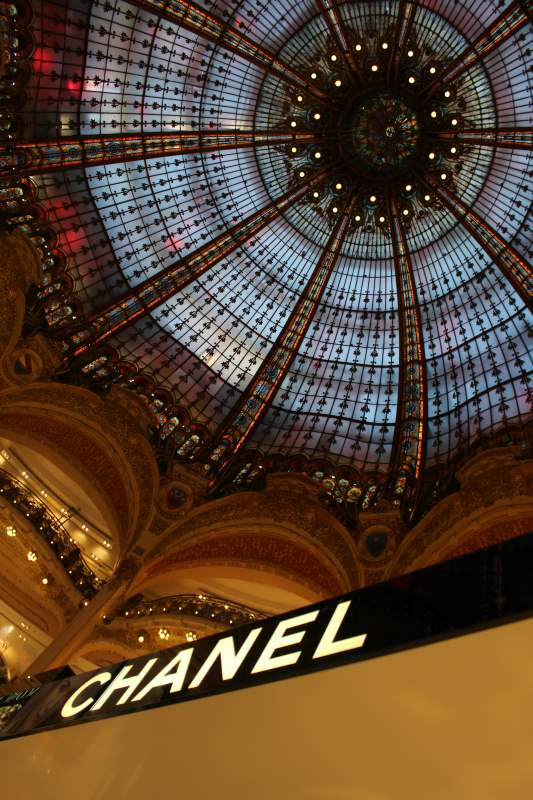 IMAGE: View looking up to the stained-glass cuppola of Galeries Lafayette