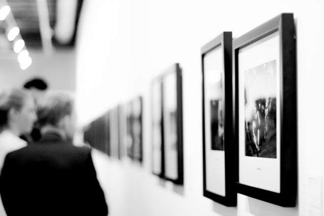 IMAGE: Visitors enjoying a photography exhibition