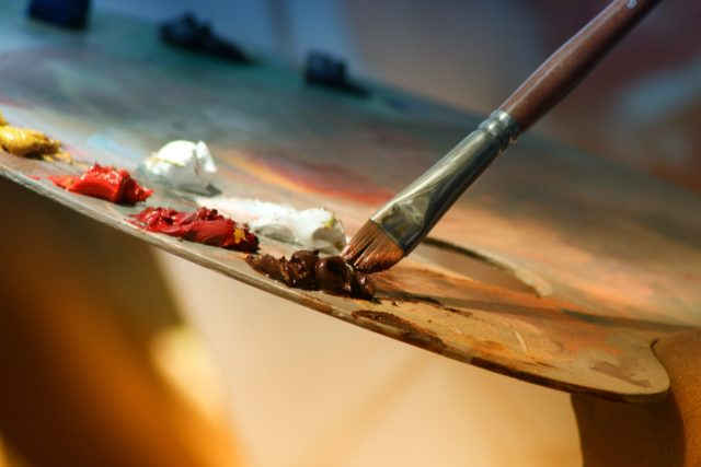 IMAGE: Photo showing a paint palette and paintbrush
