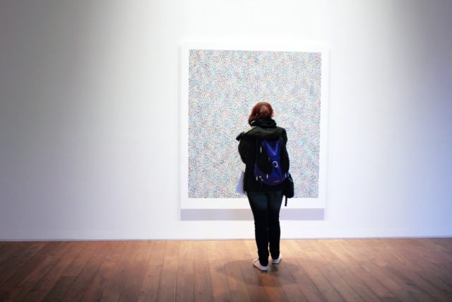 IMAGE: Visitor enjoying an exhibition of contemporary art
