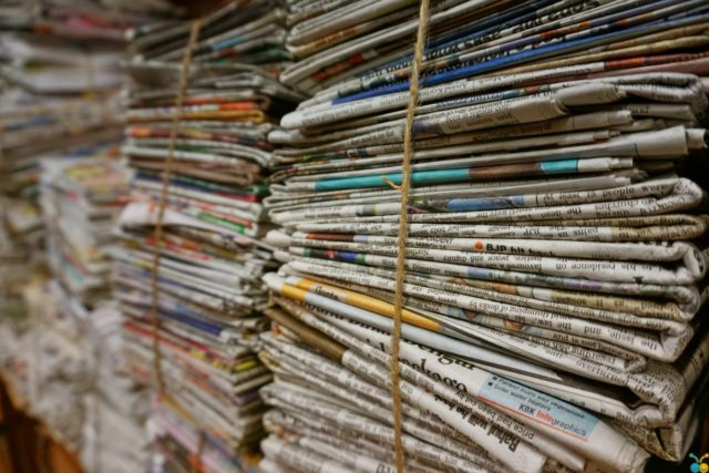 IMAGE: Piles of newspapers tied up with string