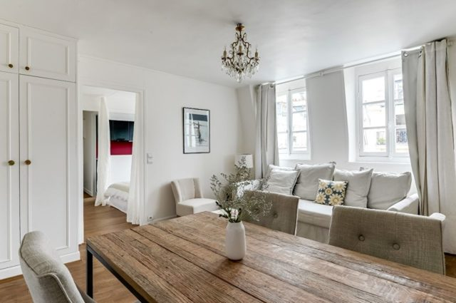 IMAGE: Lounge and dining area of Professor Hansen's apartment, which is looked after by the property management service of VINGT Paris