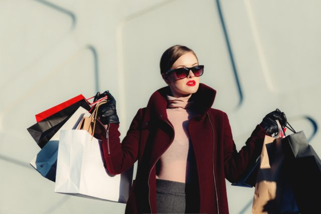 IMAGE: Smartly-dressed lady with lots of shopping bags having been to the sales
