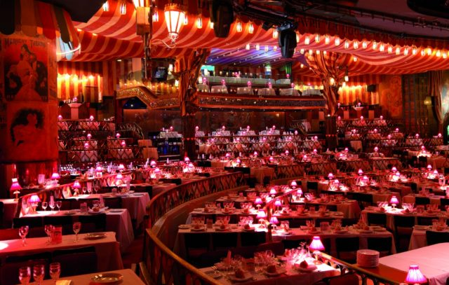 IMAGE: View of the seats and tables at the Moulin Rouge