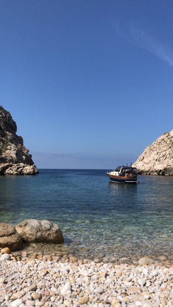 IMAGE: Tiny little cover with boat in Ibiza