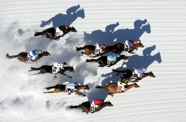 IMAGE: Horses racing across the snow on the frozen lake