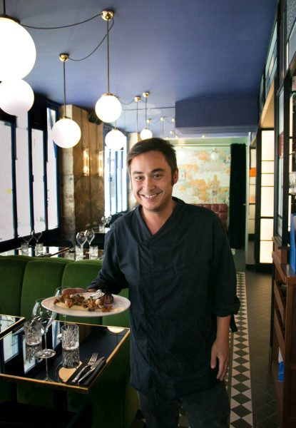 IMAGE: A smiling waiter at Les Foodies in the Marais
