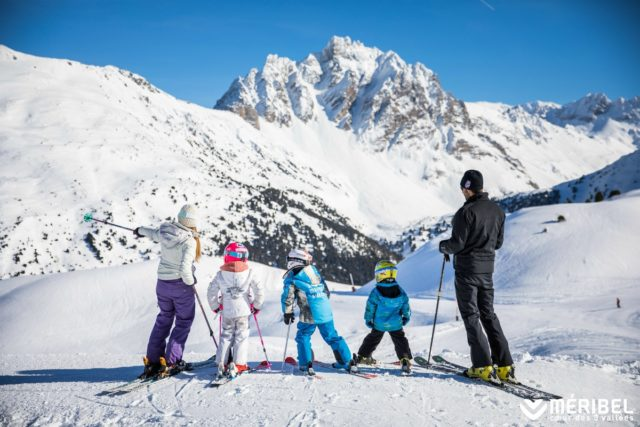 Family of skiers on the slopes at Méribel